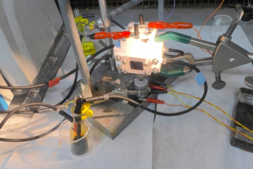 A solar-charged battery setup in a laboratory